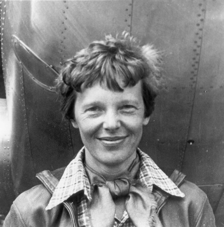 amelia_earhart_standing_under_nose_of_her_lockheed_model_10-e_electra_small-e1496317926705.jpg
